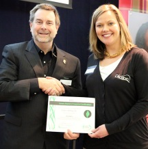 Tom Eggert (left), executive director of the Wisconsin Sustainable Business Council presents Green Masters Award to Tonya Umbarger (right), program manager at Didion Milling